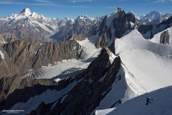 Andy soloing high up on Drifika N Ridge. Views over Masherbrum, K2 and Broad peak