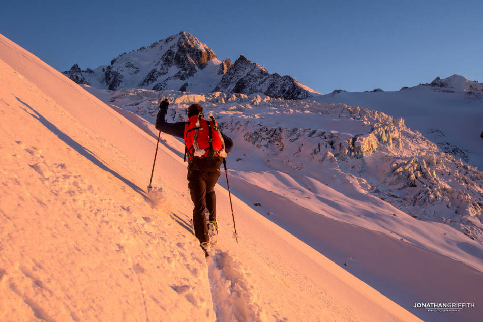 David tours in to the Albert Premier Hut at sunset