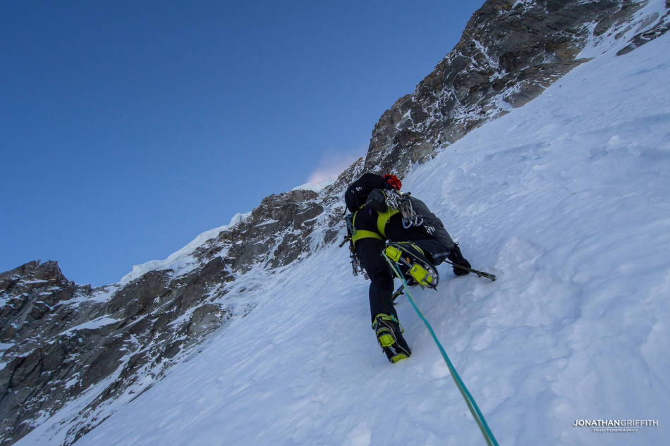 Climbing out of the fall zone of the seracs above