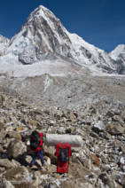 Porters carrying all sorts of luxuries in to Everest Base Camp. Pumori in the distance
