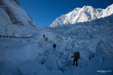 Load carrying at dawn in the Khumbu Icefall, Nuptse in the distance