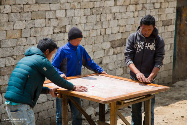 Kids play a board game in Namche Bazar