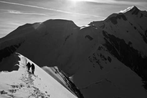 Two climbers on the Bionassay ridge, Mont Blanc in the background