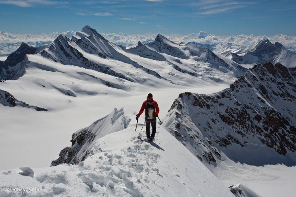 Ueli heading back down the normal route of the Monch with the Oberland stretching as far as the eye can see