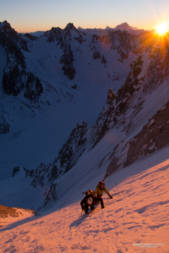Two skiers on the Couturier at sunrise