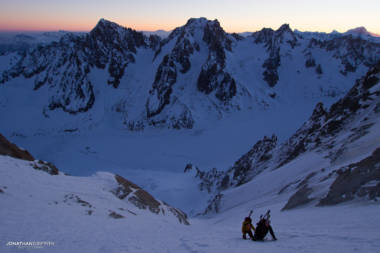Two skiers on the Couturier at day break