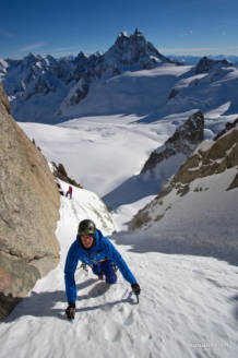 Max questing out of the sun and in to the cold couloir with the Grandes Jorasses in the backgorund