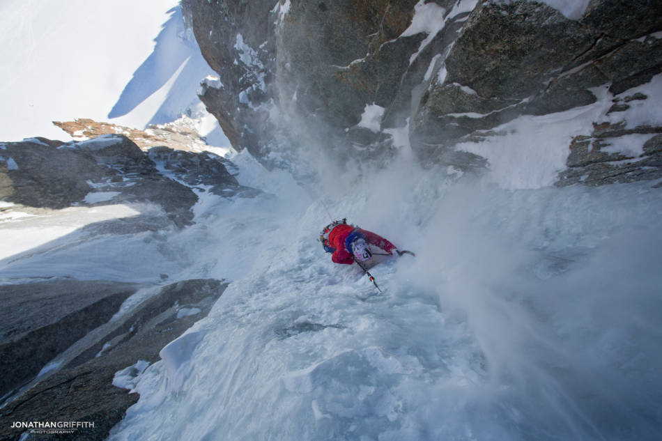 Steph taking the spindrift on the last pitch of Supercouloir