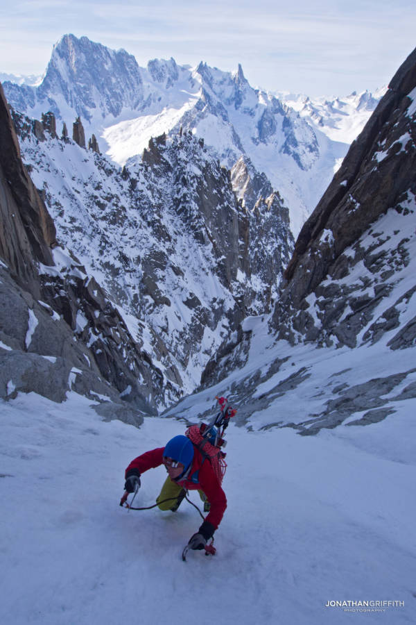 High up in the couloir with the Grandes Jorasses North Face in the background