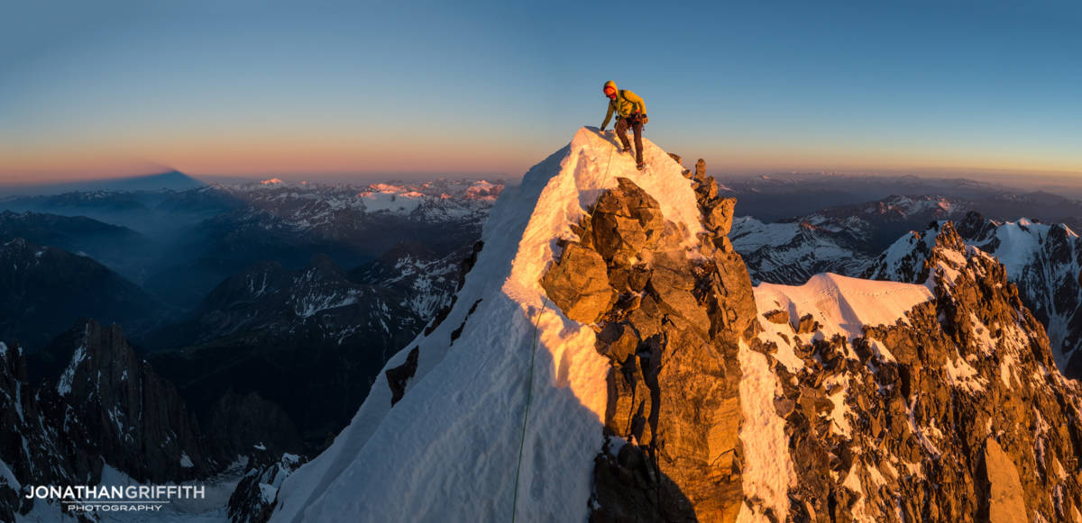 Sunset high up on the Brouillard Ridge to the summit of Mont Blanc. On the left the immense shadows of Mont Blanc itself, our end point, stretches far out in to Italy.