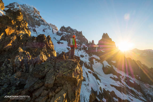 Ally takes in the sunrise over the Peuterey Integral from the Aiguilles Rouges du Brouillard