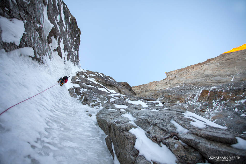 Will in the first gully as the sun hits the Manitua headwall