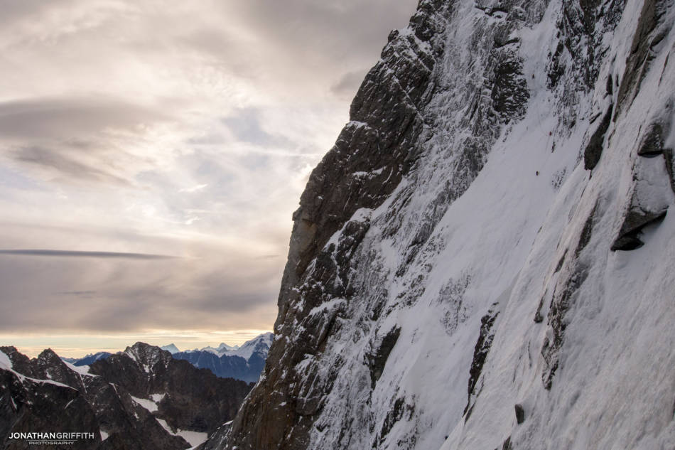 Climbers moving up the crux of the Colton-Macintyre on an unusually fat year for ice