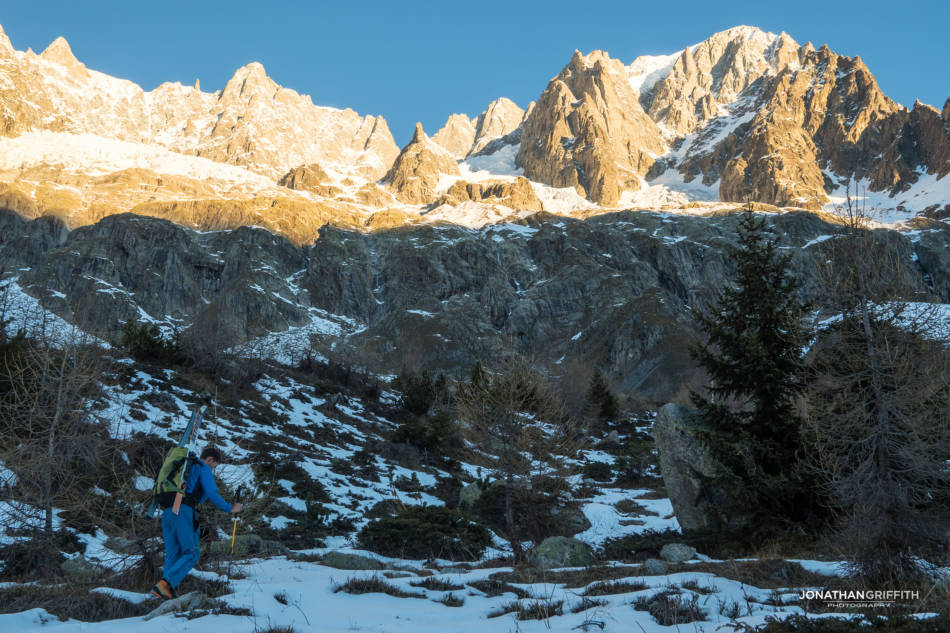 Walking in at sunrise, Grandes Jorasses in the distance